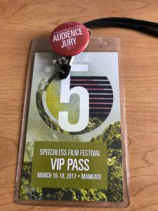 My badge and audience jury button from the Speechless Film Festival.